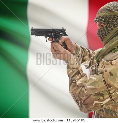 Male With Gun In Hand And National Flag On Background - Italy