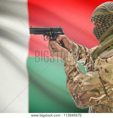 Male In With Gun In Hand And National Flag On Background - Madagascar