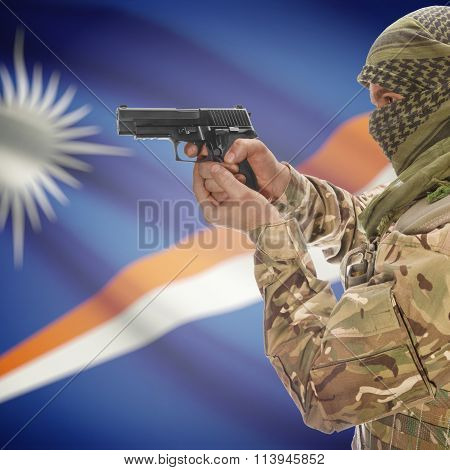 Male In With Gun In Hand And National Flag On Background - Marshall Islands