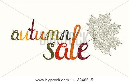 Autumn sale inscription with maple leaf.