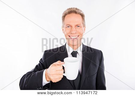 A Mature Handsome Man With A Cup In His Hand