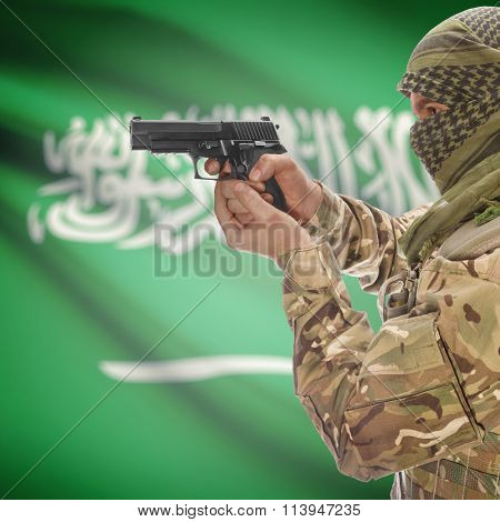 Male In With Gun In Hand And National Flag On Background - Saudi Arabia