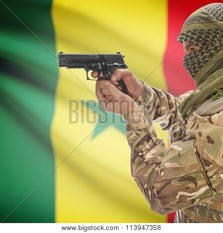 Male In With Gun In Hand And National Flag On Background - Senegal