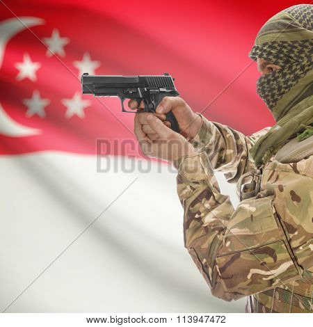 Male In With Gun In Hand And National Flag On Background - Singapore