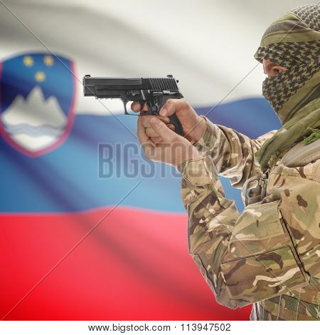 Male With Gun In Hand And National Flag On Background - Slovenia
