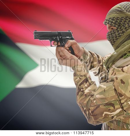 Male With Gun In Hand And National Flag On Background - Sudan