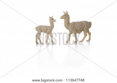 toy llama with cub