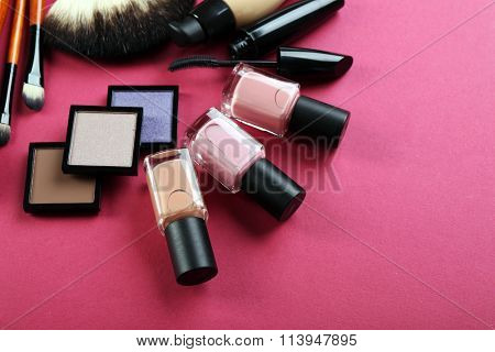 Cosmetics on pink background