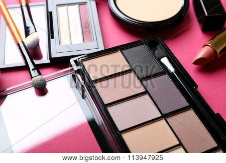 Cosmetics on pink background, closeup