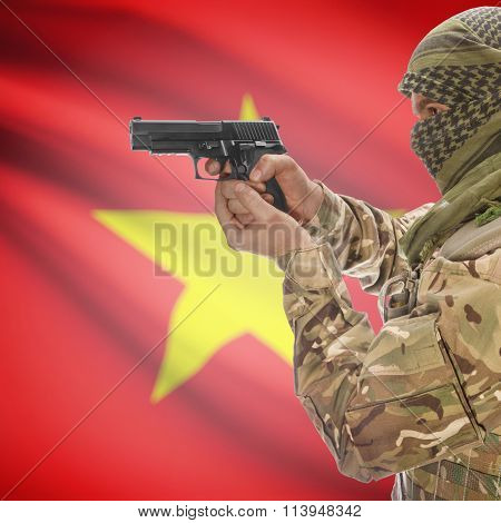 Male With Gun In Hand And National Flag On Background - Vietnam