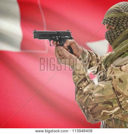 Male In With Gun In Hand And National Flag On Background - Wallis And Futuna