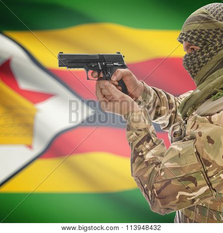 Malein With Gun In Hand And National Flag On Background - Zimbabwe