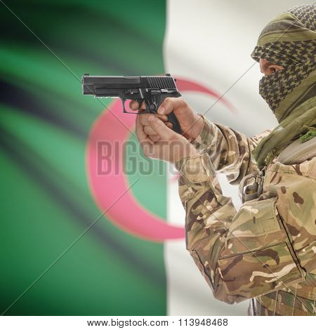 Male In With Gun In Hand And National Flag On Background - Algeria