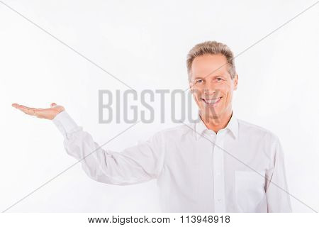 A Smiling Mature Man With Wrinkles On The White Background