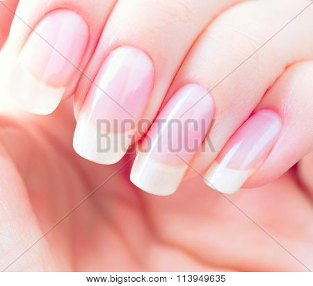 Beautiful healthy natural nails. Beauty long woman nails close up