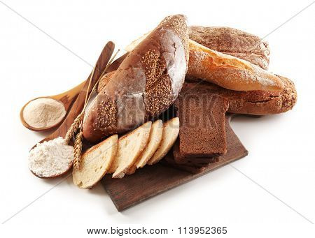 Bread with flour and ears on cutting board isolated on white