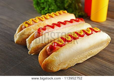 Tasty hotdogs on wooden background