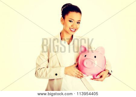 Business woman with a piggybank.