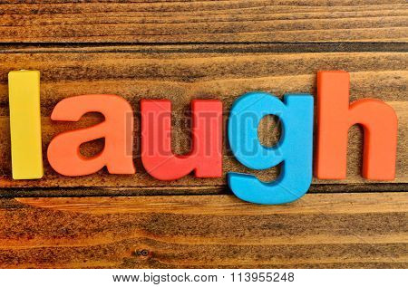 Laugh Word On Table