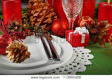 Table appointments with present box and Christmas decoration background