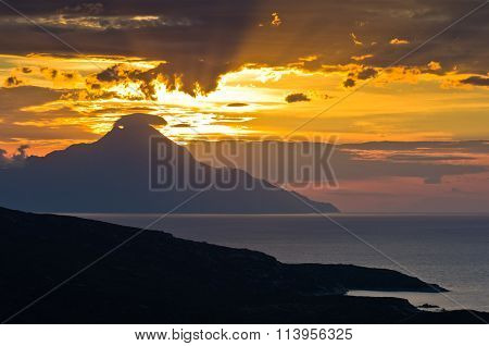 Greek coast of aegean sea at sunrise near holy mountain Athos