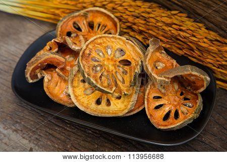 Dry Bael Fruit Tea (aegle Marmelos) On Dark Vintage Wood.