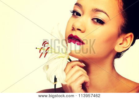 Beauty face of woman with lily flower.