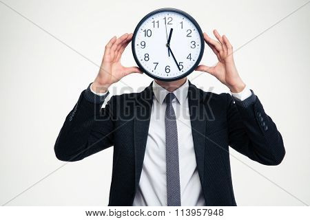 Businessman in black suit and white shirt with clock instead of head isolated over white background