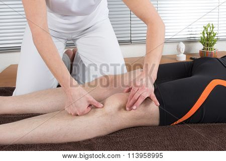 A Picture Of A Physio Therapist Giving A Knee Massage