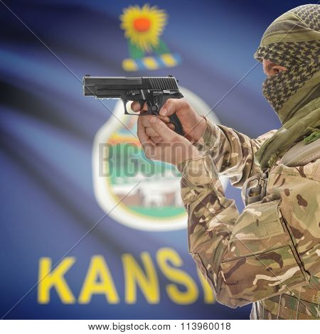 Male In With Gun In Hand And Flag On Background - Kansas