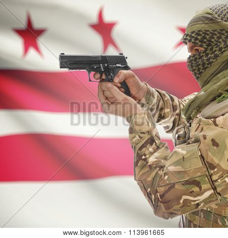 Male In With Gun In Hand And Flag On Background - District Of Columbia