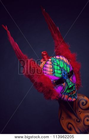 Mannequin in mask and wings