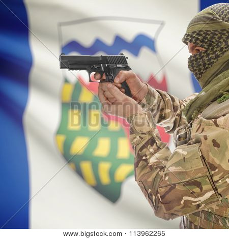 Male In With Gun In Hand And Canadian Province Flag On Background - Northwest Territ