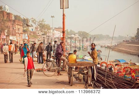 Citylife Scene With Cyclist And Tea Masala Trader With River Behind