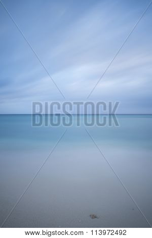 a long time exposure shooting / shot of the sea and blue cloudy sky