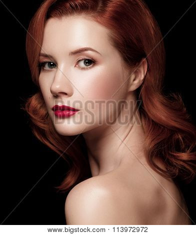 Closeup Portrait Of A Beautiful Red-haired Girl Half-turned Over Black Background