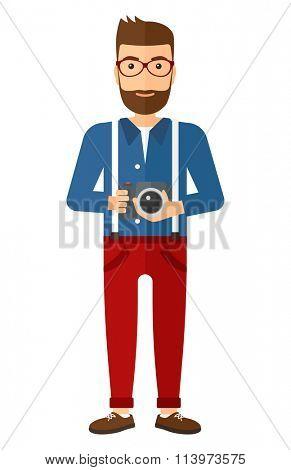 Smiling photographer holding camera.