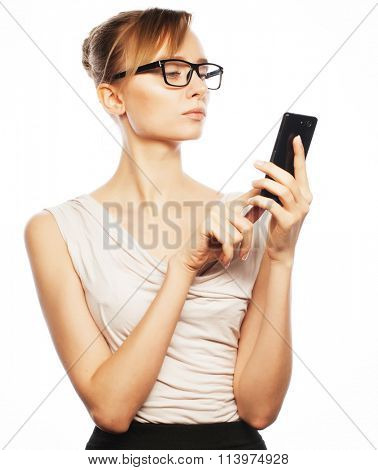 Young business woman calling by phone
