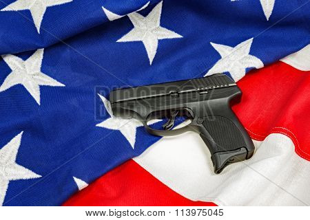 Hand Gun on American Flag