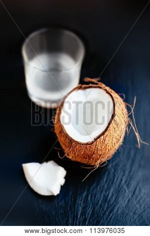 Coconuts With Milk. ..coconut With Coconut Milk In A Glass On Dark  Background With Copy Space.