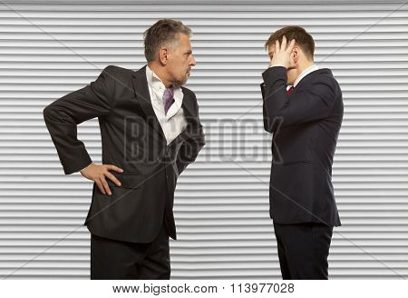 Business competition, conflict concept. Two businessman are trying to come to an agreement