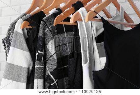 Collection of male and female clothes hanging on a rack