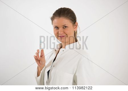 Young Doctor With Syringe