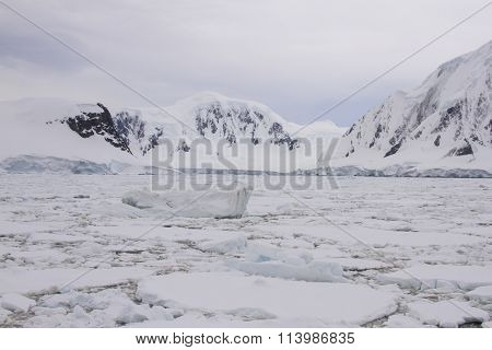 Pack Ice With Icebergs Along Antarctic Coastline