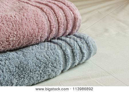 Two Towels On Simple Bedsheet