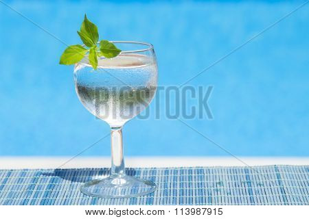 Glass of water on bamboo straw mat