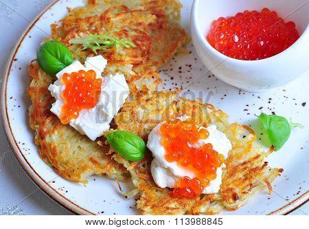 potato pancakes with sour cream and red caviar