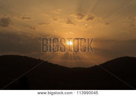 Golden sunset over mountains