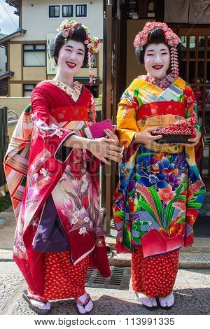 Kyoto, Japan - October 14, 2015 : Smiling Maiko, Apprentices Geisha, In Kyoto, Japan.