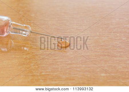 Syringe Over Vooden Table